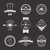 A set of logos, labels and elements for the club of archery in linear style on a black background. Suitable for design, advertising, posters.