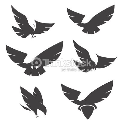 Set Of Black Silhouettes Of Graceful Flying Eagles stock