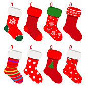 Set of Christmas socks in red colors with various patterns. Vector illustrations. EPS10, JPG and AI10 are available