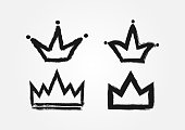 Set of crowns drawn by hand with a rough brush. Grunge, sketch, graffiti. Isolated black icons, symbols, symbols. Vector illustration.