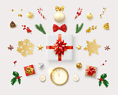 Set of decorative 3d elements, fir branches, Christmas ball, candy, holly berries, top view gift, clock, snowflake isolated on white background for Christmas and New Year design. Vector illustration.