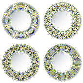Set of four decorative plates with a circular blue pattern, top view. White background. Vector illustration.