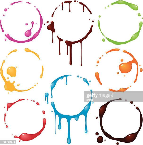 Set of eight colorful glass stains on a white background