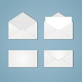 A set of white open and closed envelopes from the front and back, with paper inside and without. Mail, letter, correspondence, quick instant message. Blank invelopes.