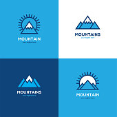 Set of four geometric linear mountain icon in blue and white colors. Winter sport symbol.