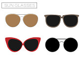 A set of four sunglasses. Summer time. Isolated objects. Sun glasses