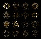 Set of gold isolated sunburst rays design elements on a black background.