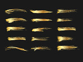 Set of golden paints, metallic gradient brush strokes, brushes, lines. Artistic design elements.