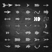 Set of hand drawn arrows on black chalkboard background. Design element in vector