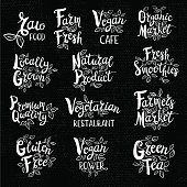 Set organic logo, lettering design, calligraphy logotype, leaf, set of stickers, green labels Eco, bio, locally grown, natural, detox, healthy, menu, gluten free Hand drawn vector illustration