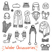Set of hand drawn women accessories. Winter hats, scarfs, mittens and socks. Fashion collection. Black and white doodle illustration.