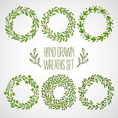 Set of hands drawn decorative wreaths. Vector illustration EPS10
