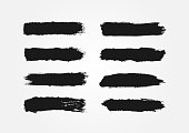 Set of ink strokes. Eight isolated black smears. Grunge. Lines drawn by hand with brushes. Vector illustration.