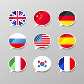Set of nine colorful speech bubbles with flags, different language concept