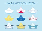 Set of nine cute origami paper boats or ships with different patterns and decorations. Sea theme. Vector illustration.