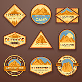 Set of nine mountain travel emblems. Camping outdoor adventure emblems, badges and logo patches. Mountain tourism, hiking. Forest camp vector labels in vintage style