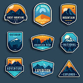 Set of nine mountain travel emblems. Camping outdoor adventure emblems, badges and icons patches. Mountain tourism, hiking. Forest camp vector labels in vintage style