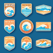 Set of nine summer holidays emblems. Labels with sun, waves, and sand in bright blue and orange colors. Beach emblems, badges and logo patches. Summer holidays, surfing. Vacation labels in vintage sty