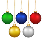 Set of realistic shiny colorful hanging christmas baubles isolated on white background.