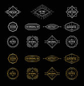 Set of shiny gold and white geometric vintage labels with the place for text. Vector illustration.