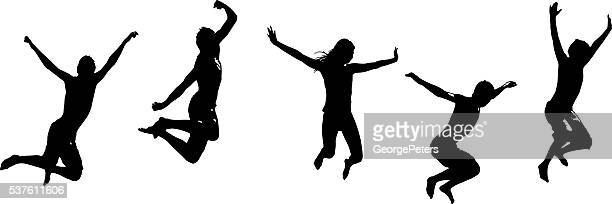 Set of Silhouettes of Happy teenagers jumping for joy