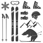Set of skiing equipment silhouette icons. Set include skis, mountain, bear, gloves, goggles, helmet and snowflake. Winter equipment icons for family vacation, activity or travel. For logo design, patc