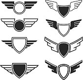 Set of the empty emblems with wings. Design elements for icon, label, badge, sign. Vector illustration
