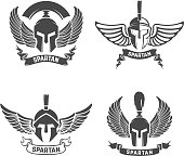 Set of the spartan helmets with wings. Design elements for label, emblem, sign, brand mark. Vector illustration.