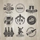 Set of vector craft beer logos and badges. Retro beer labels on vintage wooden background