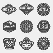 set of vintage bicycle shop and repair badges and labels. bike sales and service. vector illustration