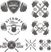 Set of vintage gym emblems, labels and design elements.