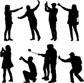 Set silhouettes man and woman taking selfie with smartphone on white background.