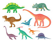 Set with various kinds of colored painted dinosaurs on white background