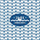 Shark fin among the waves seamless pattern and dangerous emblem. Blue print on white background