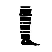 Shin brace glyph icon. Shin support. Adjustable calf brace. Vector silhouette. Lower leg compression wrap. Leg injury treatment, pain relief. Calf muscle injury, sprain