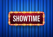 Showtime. text with electric bulbs frame on blue background. Vector illustration