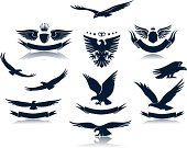 A number of eagles and insignias with eagles.