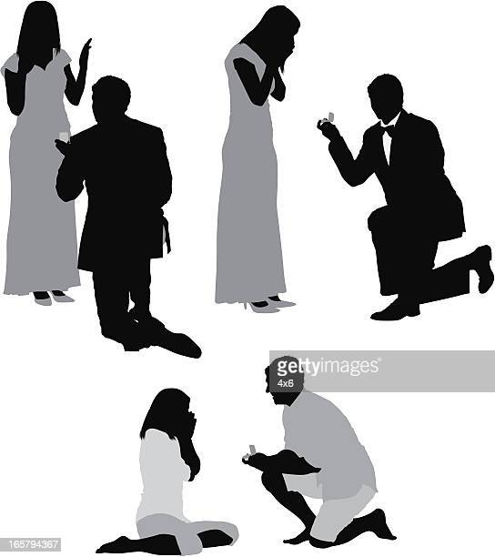 Silhouette of men proposing his girlfriends