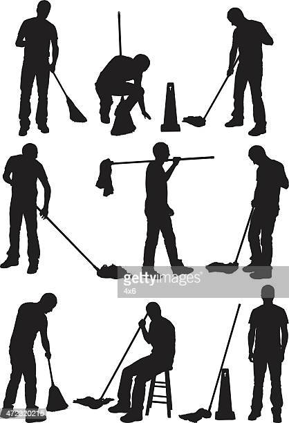 Silhouette of people cleaning the floor