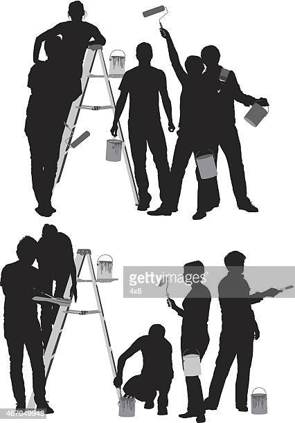 Silhouette of people painting