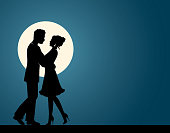 Silhouettes of loving men and women hugging each other and dancing against the background of the moon