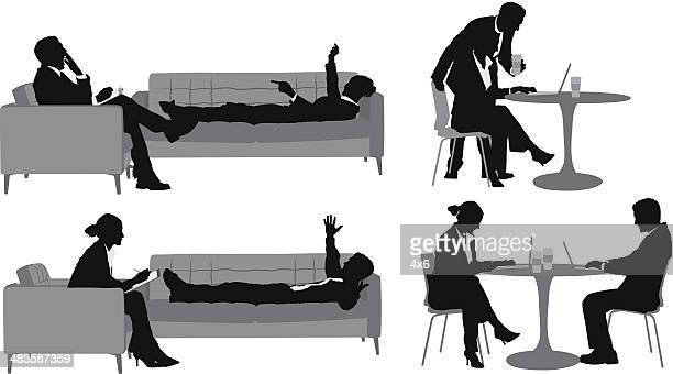 Silhouettes of businessman with a female executive
