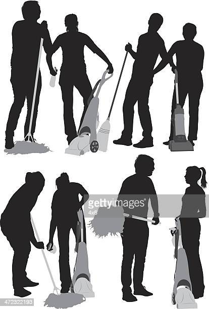 Silhouettes of couples cleaning the floor