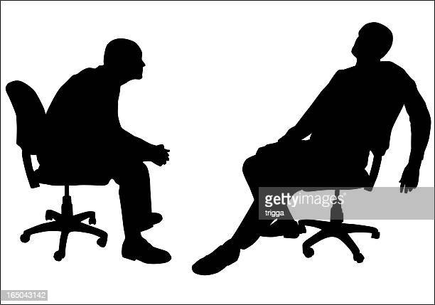 Silhouettes of two men in office chairs