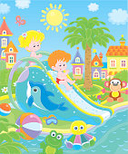 Little kids sliding down from a water slide in a summer waterpark, vector illustration in a cartoon style