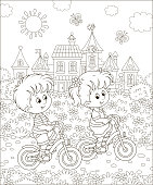 Little kids riding bicycles near a cute small town on a sunny summer day, black and white vector illustration in a cartoon style for a coloring book
