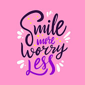 Smile more worry less. Hand drawn vector lettering. Positive quote isolated on pink background