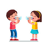 Smiling standing preschool boy and girl kids enjoying drinking water holding glasses. Happy, kids drinking water hydrating. Children cartoon characters. Quench thirst. Flat style vector illustration i
