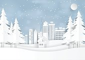 Snow and winter season with urban landscape for merry christmas and happy new year paper art style.Vector illustration.