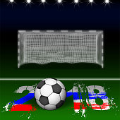 Soccer ball on against an empty soccer goal, in a stadium with lighting. Football Championship in Russia.